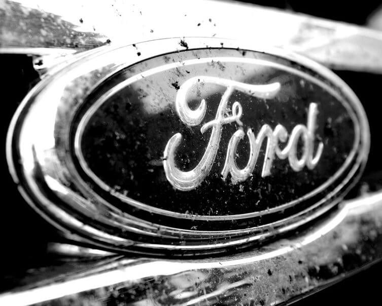 FORD GEARS DOWN IN RESTRUCTURING BID