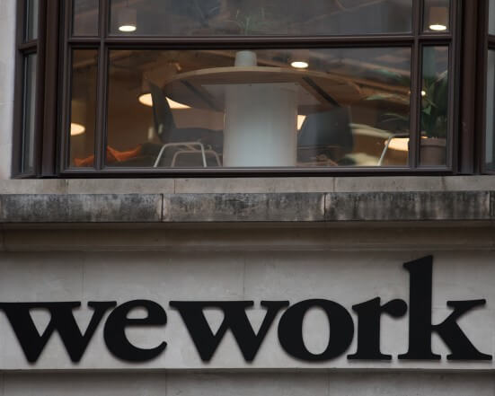 WEWORK PLANS TO LAYOFF 2,000 WORKERS